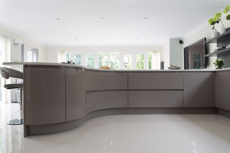 High gloss curves. Luxury Kitchen Design by Mitchell and Stanley.