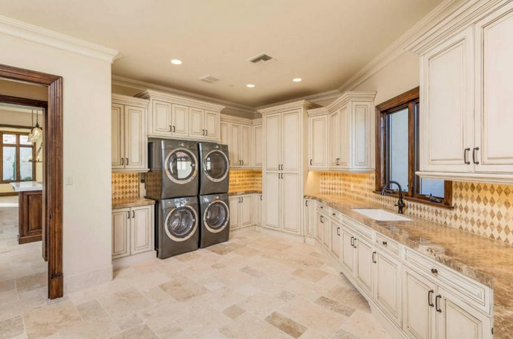 Large Luxury Laundry Room With Dual Wash Dry Units And