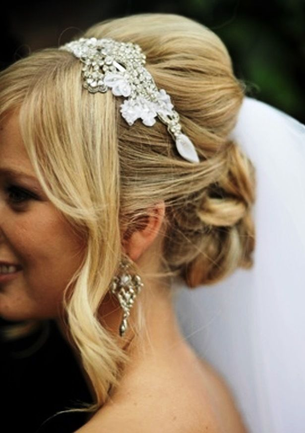 Bride's bouffant updo chignon bridal hair