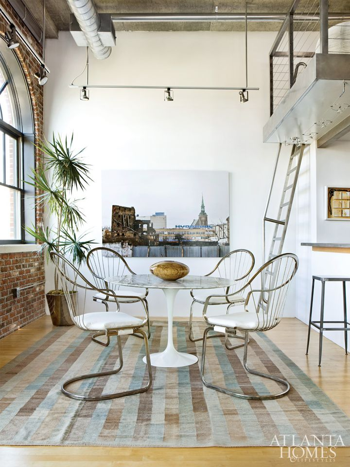 Sculpted Stainless Chairs Keep The Space Open While Reiterating The Loft  Ladder And Landing. Marble
