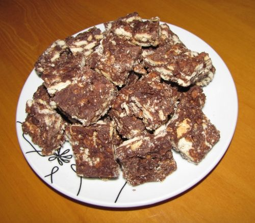 Marie Biscuit Fudge Recipe: 1/2 recipe in this order: 1 stick melted butter, 1 egg, 1 cup powdered sugar, 1 T cocoa, 1 t vanilla, 2 cups tea biscuits