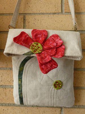 .think: antique homespun w/paisley flower, antique button center; metallic cord 'stem...
