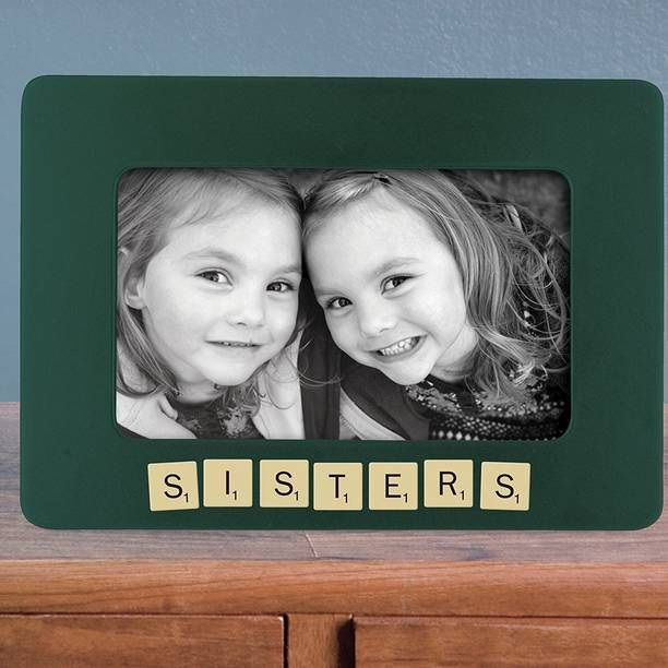Personalise your favourite photos using the magnetic Scrabble style letter tiles on the metal photo frame.