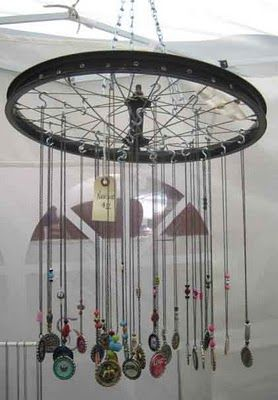 I also saw a few S hooks and wire making the displays work. A bike rim suspended from the canopy is a great way to make use of vertical space and get pendants right at eye level.