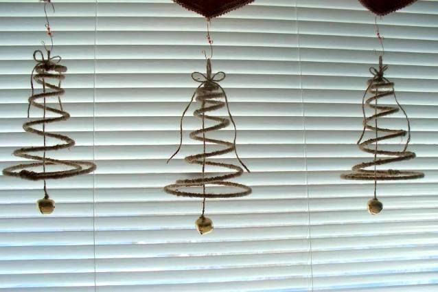 Sue wrapped some springs with twine Christmas tree bells.  More ideas on this site