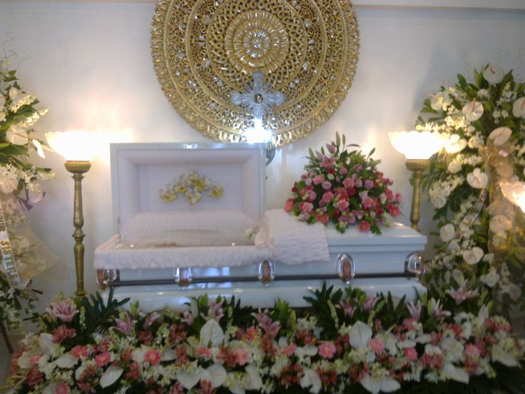 Sylvia Topacio Rojas ( Dec.13, 1915-Dec.12,2014)..Her white casket surrounded by flowers at the Sapinoso Grand Funeral Homes in Imus ,Cavite .Photo taken December 15, 2014. Farewell, Auntie Syl.