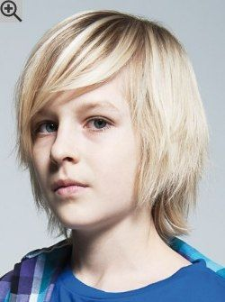Long and low maintenance hairstyle for boys. Layers and much texture keep the hair light.