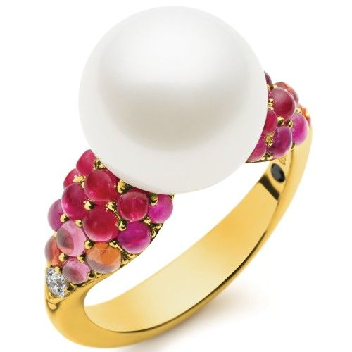 The Aurora Vivid Ring is a marvel of grace and glamour. Its single luminous, untreated Australian South Sea Pearl rises from golden shoulders that are precisely grain-set with stunning Cabochon-cut rubies, sapphires, tourmalines and diamonds reflecting the dégradé colour palette of an intense sunset sky. View our collection of Australian South Sea pearls at www.rutherford.com.au