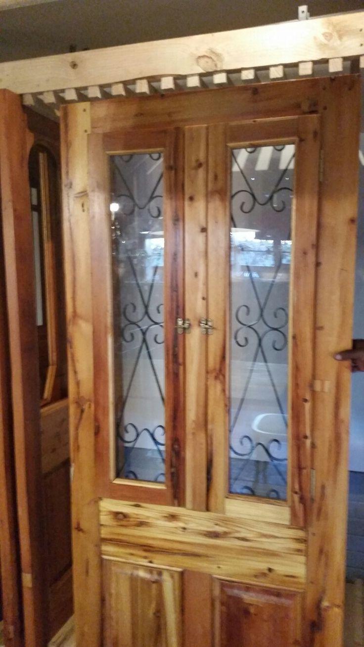 Spanish shutter door.  Opens up with steel insert.
