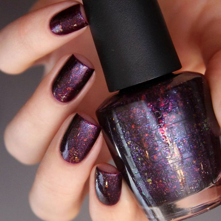 OPI Merry Midnight with purple and holo flakie.