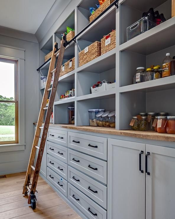 Cottage Style Kitchen Pantry Featuring Gray Pantry Cabinets With A
