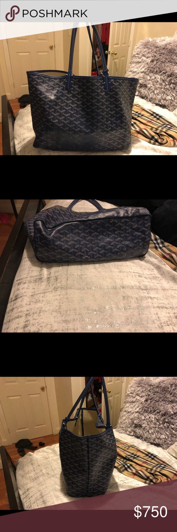 Goyard Tote medium size Royal blue A loved bag. The paint on the bottom on the bag is wearing off. Only certain spots. Inside has marks. Other than that the bag is literally still great quality. So much more life this bag has to offer. It is a pm, which actually holds a great abundant of things.  %100 authentic.  Purchased from Barneys, although I no longer have the receipt.    The little pouch is not for sale. Goyard Bags Totes