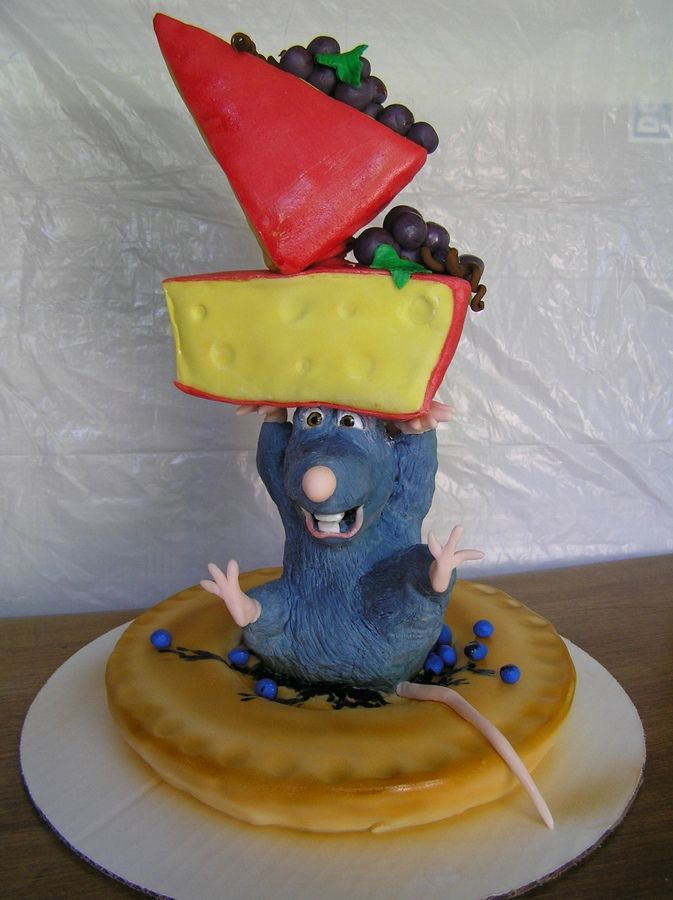 """The """"pie"""" and cheeses are all fondant covered pound cake. Remy the little chef is rice cereal marshmallow treats covered in fondant.  All the other berries and grapes, etc  are fondant as well."""
