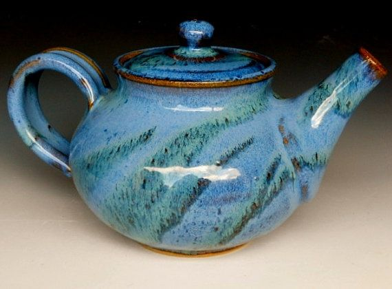 Nice example of a traditional teapot form in a contemporary piece.  I like how the glaze breaks over the edges on this piece.