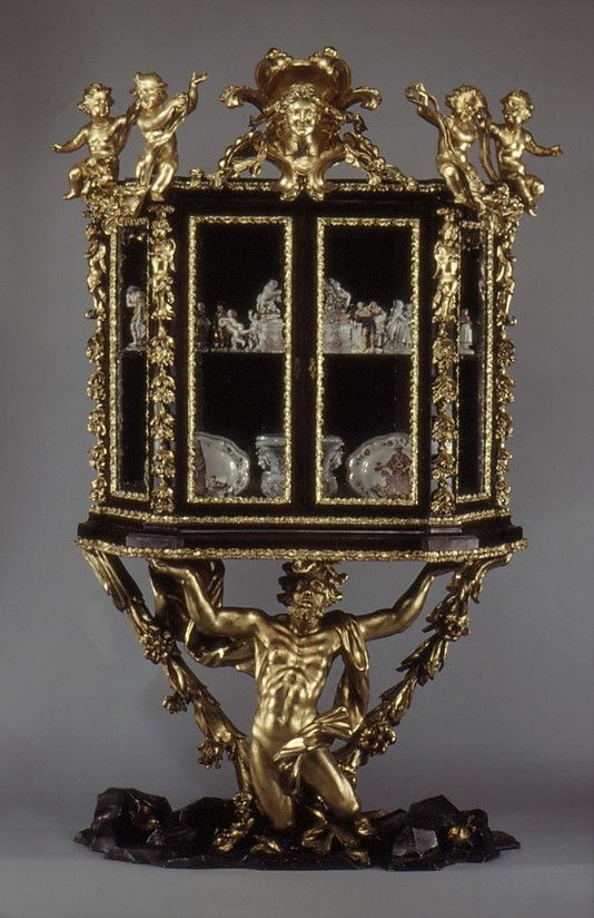Showcase on stand / late 17th C, Rome. Walnut; carved, painted, and gilded linden wood; mirror glass.
