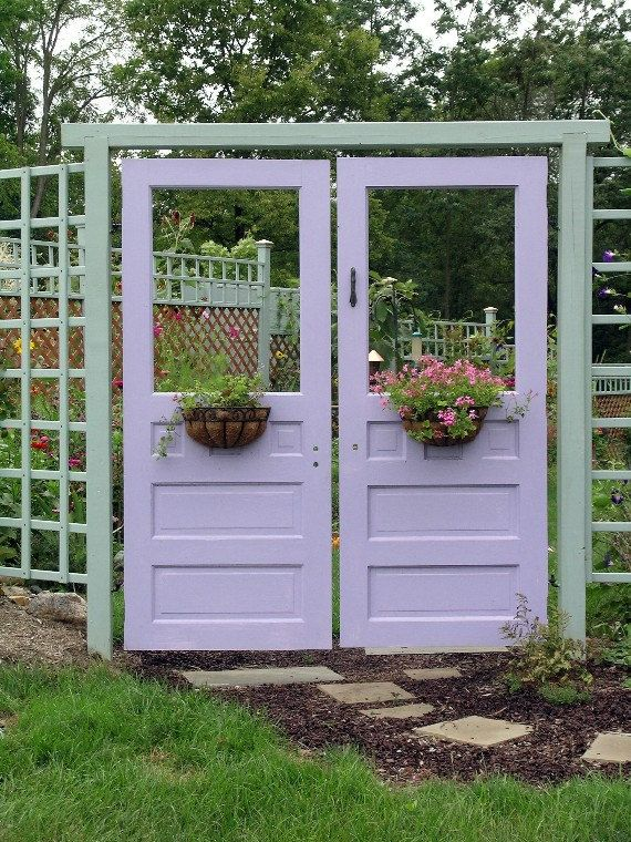 This is an interesting take on the traditional garden gate. I like the pairing of the green and purple together.