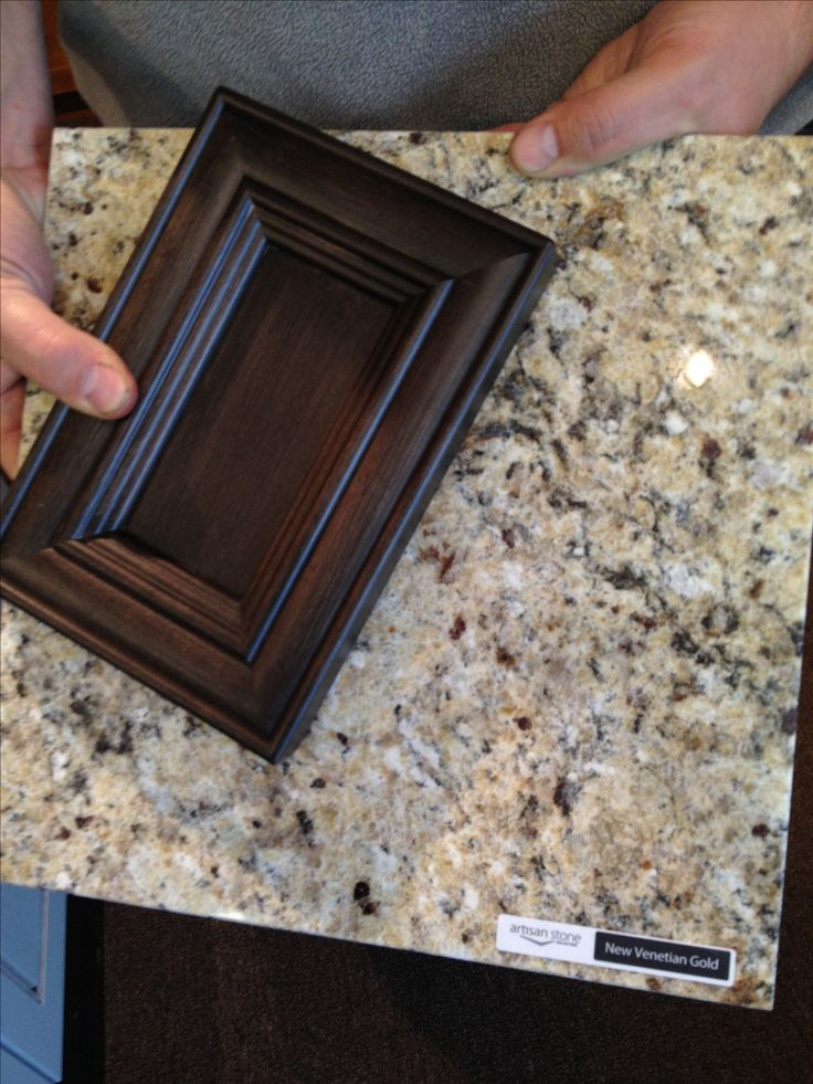 Kitchen makeover: Harmony Maple Vintage Charcoal cupboards with New Venetian Gold Artisan Quartz countertops!