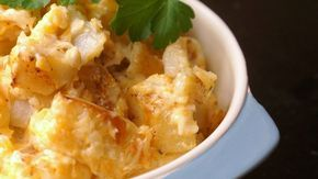 This is a delicious side dish with cheese, potatoes, and Ranch dressing! It is a great complement to a barbeque or any potluck meal.