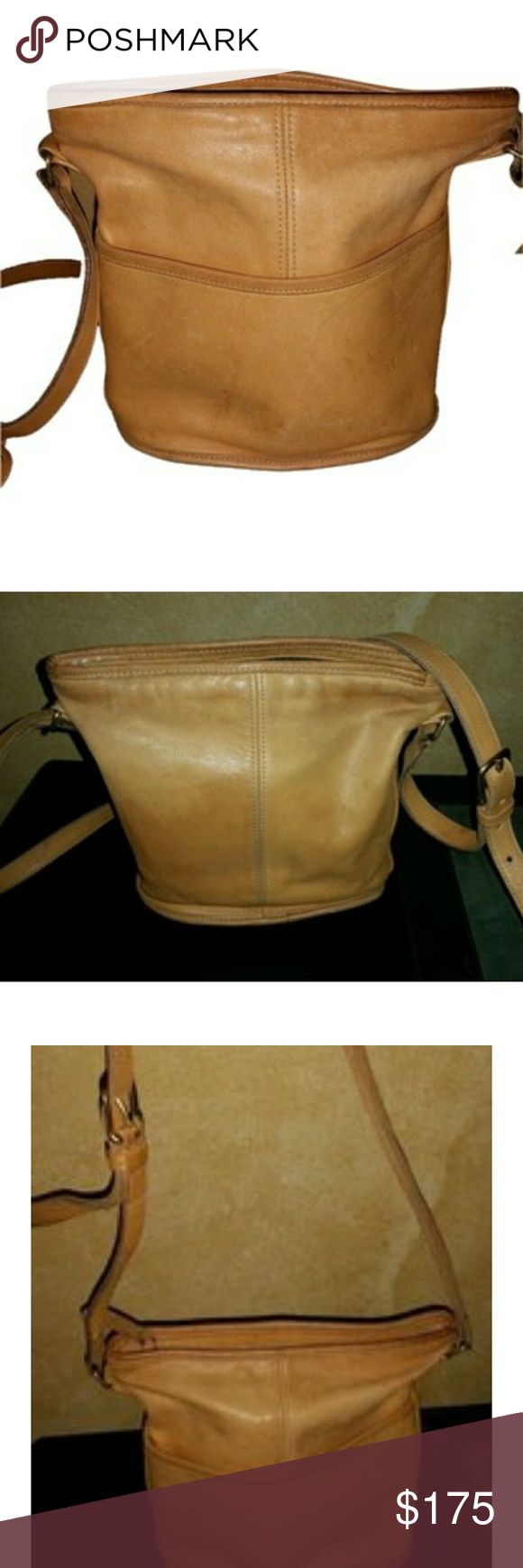 Coach Shoulder bag Vintage 100% authentic Coach hobo shoulder bag in British Tan, a warm brown soft, smooth leather.   The leather does have scuffs and some pens marks.   Two pockets, One inside slip pocket, one outside slip.   Adjustable length shoulder strap. One end has come off buckle, please refer to photo. An easy fix for a cobbler and you have a stunning new bag!   Made in USA No#0469-116 Coach Bags Shoulder Bags
