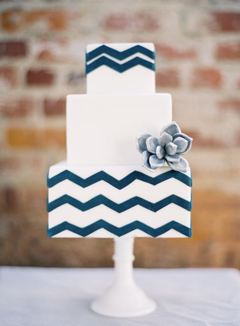 Navy chevron stripes and a candied flower transform a simple 3-tiered wedding cake into a work of art.