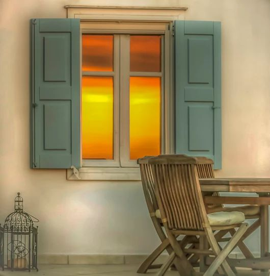 Sunset captured in a window.  #wonderful_places #sunset #house #window #macsnapshot28#travelphotography #instatravel #travel #trip #europe #greece #500px #macsnapshot #instagram #sungazing #bestplaces_togo