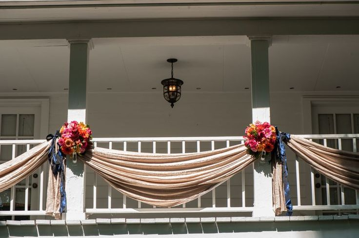 I like how the flowers are placed on each side and I like the draping of the fabric- maybe use this concept at the head table for the wedding hall