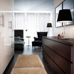 From IKEA. Create a hallway using wardrobes and a row of dressers. This technique would be great for a studio or a large square room as a way to add dimension and divide up the space.
