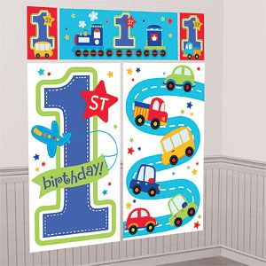 All Aboard 1st Birthday Scene Setter - 1 6m 5pk Featuring a giant 1st and a plane flying a birthday banner with trucks cars and trains this 5-piece
