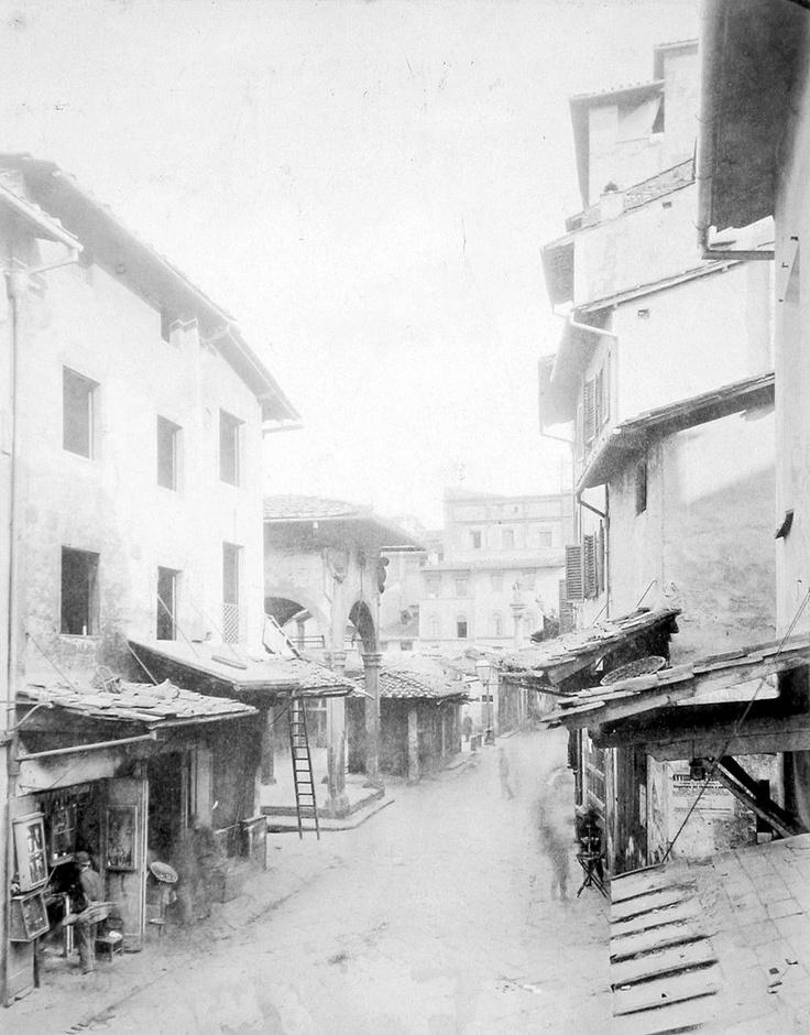 1880: Piazza del Mercato Vecchio (now Piazza della Repubblica) as seen from Via degli Strozzi. Compare this with http://pinterest.com/pin/218002438182254618/