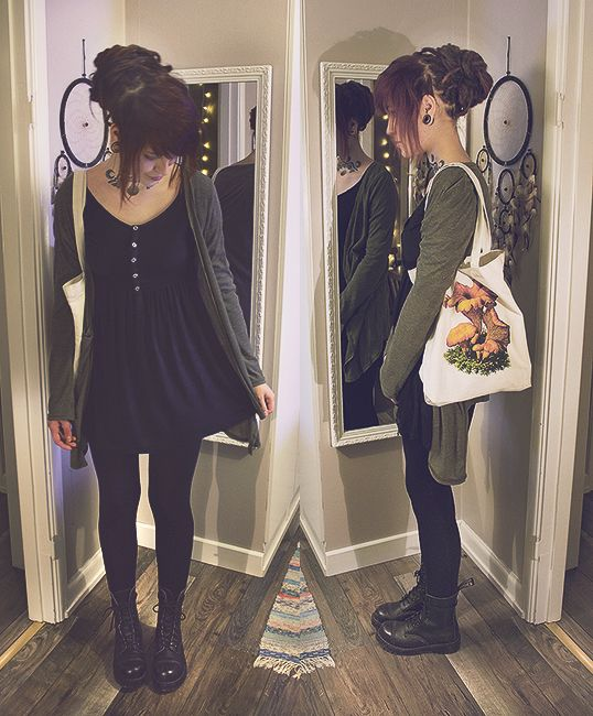 I never would have thought to combine a cute black dress with leggings and boots. Love this look.