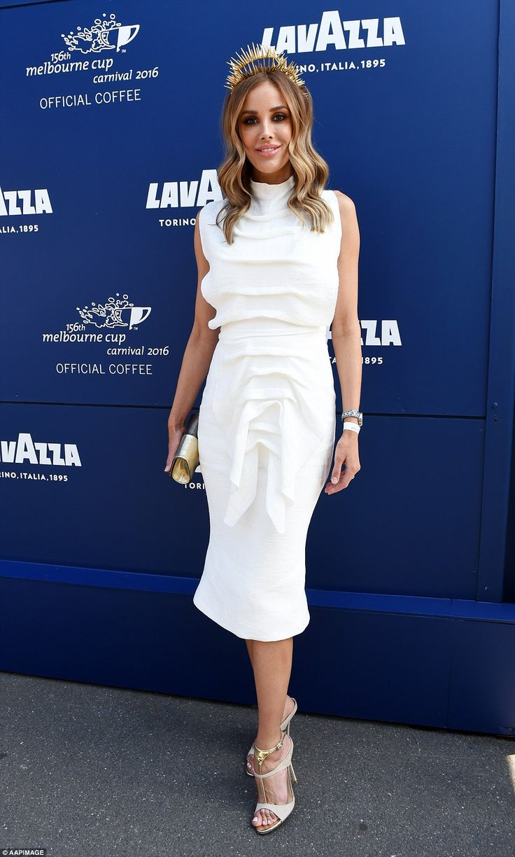 White on the mark: Television presenter Rebecca Judd ditched the black in favour of a whit...