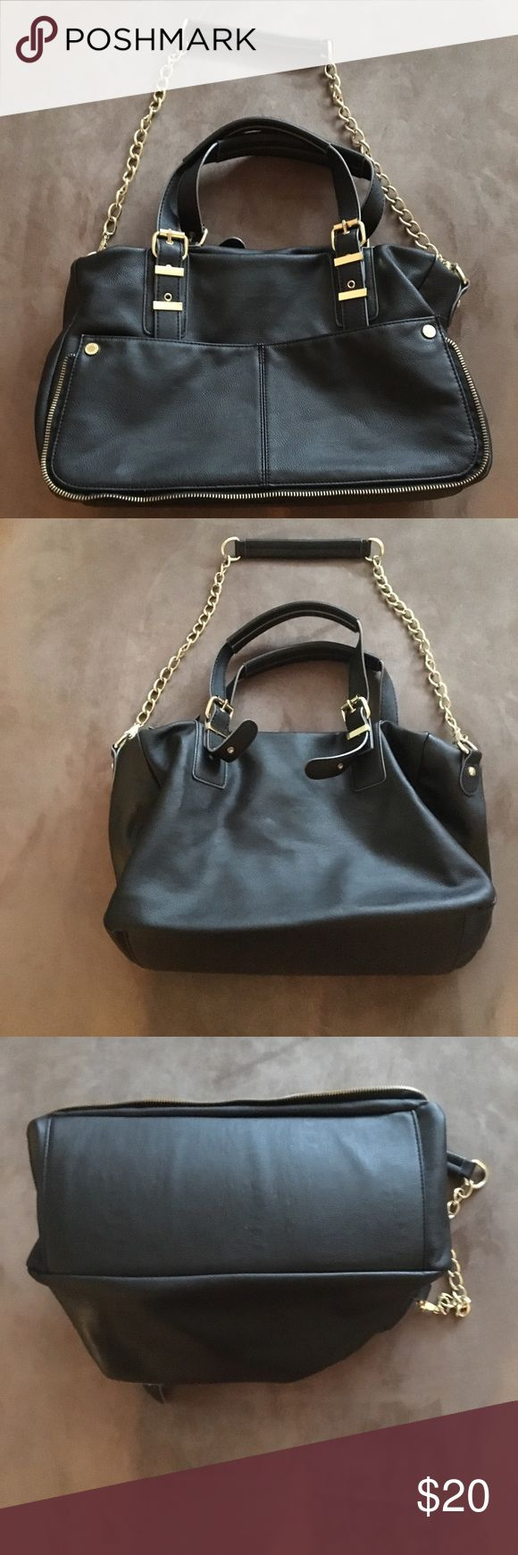 Black Steve Madden Bag Black bag with gold chains and zipper detail. I'm great condition. Like new! Steve Madden Bags Shoulder Bags