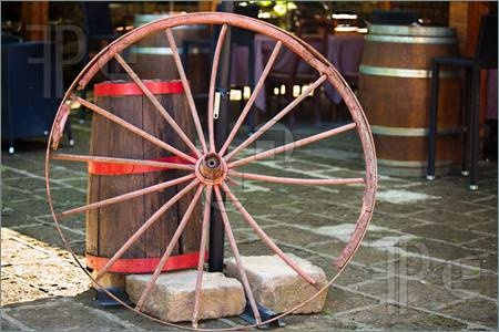 Stock photo available for sale at FeaturePics: Picture of Still life with old wheel and barrel.