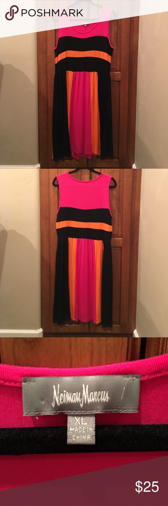 Neiman Marcus Casual Summer Dress Fun and lightweight Neiman Marcus dress that is cool and casual. The vertical lines on the bottom half are slimming.  You will love it whether you're hanging out at home, at the park or at the mall. This dress is never been worn. Neiman Marcus Dresses