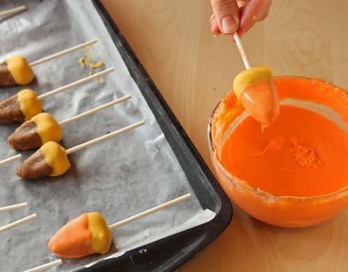 Dip cake pops in orange coating