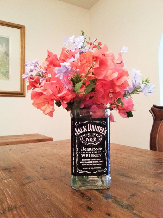 Jack Daniels glass flower vase. Great gift for a whiskey drinker. #LookingSharpCactus on Etsy www.etsy/shop/lookingsharpcactus.com