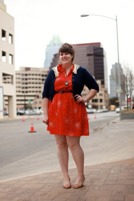 plus size navy cardigan over orange printed dress with skinny belt and flats