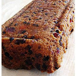 Christmas Fruitcake With Dried Cherry, Dried Mango, Dried Cranberries, Dried Currants, Citron, Dark Rum, Butter, Brown Sugar, Eggs, All-purpose Flour, Baking Soda, Salt, Ground Cinnamon, Molasses, Milk, Chopped Pecans, Dark Rum