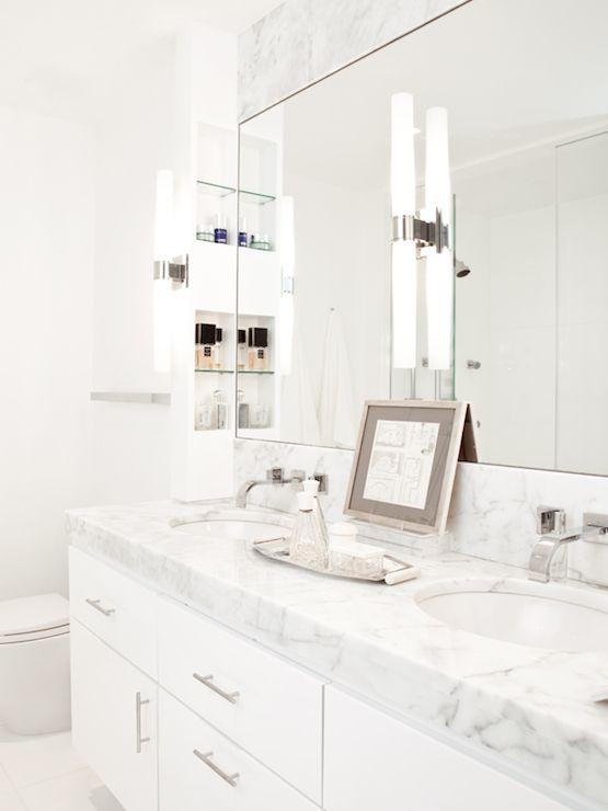 Nathan Thomas Studios  Chic white bathroom features