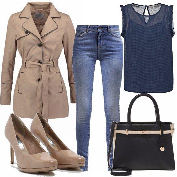 Oggi ho proprio voglia di uscire per andare a fare un po' di shopping. Mi preparo indossando una camicetta in blu navy, un paio di jeans skinny e termino il mio look minimal con un trench beige, le décolleté abbinate e la borsa a mano bi-color.