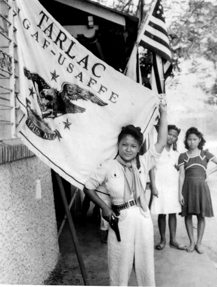 bag-of-dirt:  A young Filipino Resistance fighter poses with a flag of the United States Army Forces in the Far East following the routing of Japanese occupying forces from her province. From 20 January 1945 to 15 August 1945, Tarlac was recaptured piece by piece by combined Filipino and American troops together with the recognized Filipino guerrilla fighters against the Japanese Imperial forces. Tarlac, Tarlac Province, Central Luzon, Philippines. August 1945.