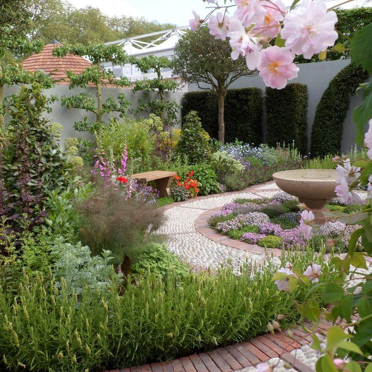 RHS Chelsea Flower Show 2016 London A Modern Apothecary Designed by Jekka McVicar Built by Crocus Sponsored by St John's Hospice #perennials #sculpture