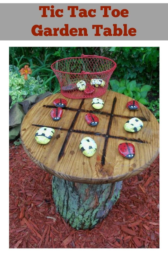 These clever DIY'ers made use of a tree stump and created a tic tac toe garden table