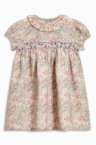 Summer occasions call for ditsy floral prints like our lilac shirred dress!