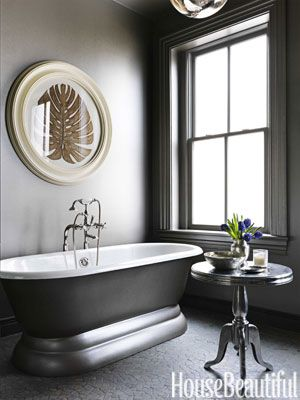 In the bathroom—walls, trim, ceiling, even the exterior of the Sunrise Specialty tub—has a silvery glow, thanks to Ralph Lauren's Regent Metallic Paint in Ambassador Sterling.