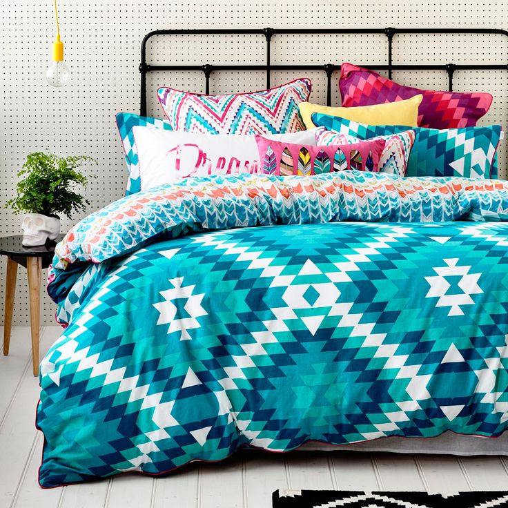 In a kaleidoscope of shades of teal and white, the Maya quilt cover is perfect for an inspirational start to the day in your bedroom. Bright European pillowcases of contrast colour and chevron patterns add further style while coordinating pillowcases complete a funky design from our exclusive teen range - Ruckus. Fully reversible for multiply styling options.