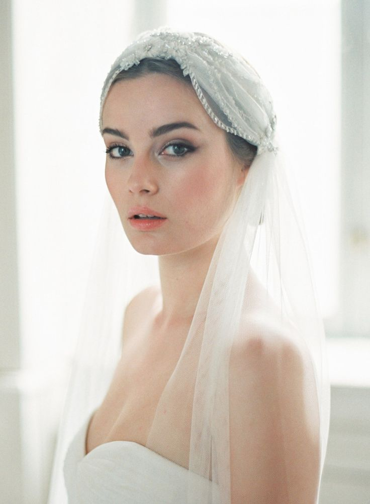 Beaded 1920s cap veil with applique flowers by Jannie Baltzer Couture | Photography by http://wedding.sandraaberg.com/