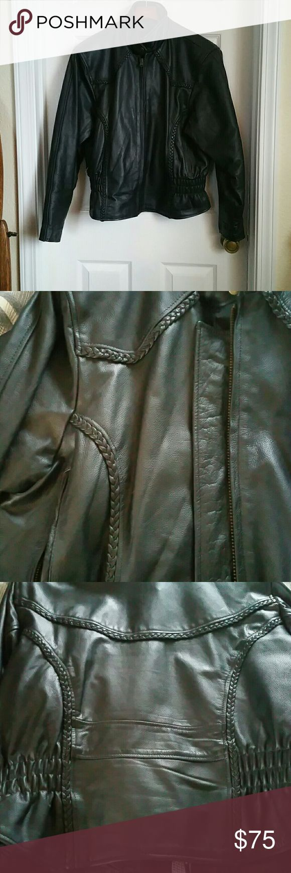 Ladies Leather Motorcycle Jacket Beautiful leather jacket with braiding detail front and back.  Little to no signs of wear.  Tag says 2XL but the last time I wore it I was a Large but bought it big enough to wear a sweater underneath.  I have a vest that matches (also listed). Jackets & Coats