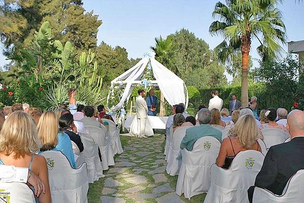 Wedding Ceremony in the tropical garden of Hotel Tamisa Golf, Mijas Costa.