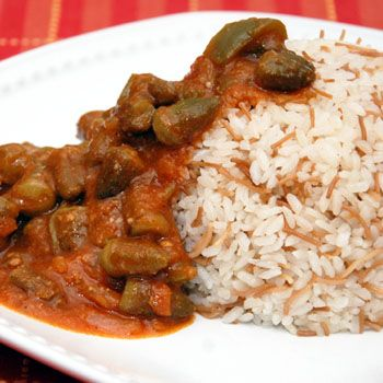 Bamia, Okra in Tomato Sauce - traditional Egyptian recipe for a dish of fried okra served in a sweet tomato and onion sauce